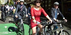 velaporter stylish cycling woman bicycling cycling in a skirt cycling in heels