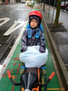 veloaporter cycling with kids cycling in the rain