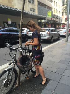 stylish cycling woman on bicycle cycle chic cycling in heels cycling in skirt