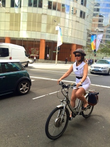 veloaporter stylish cycling cycling in heels cycling in a dress cycling in a skirt woman on bicycle