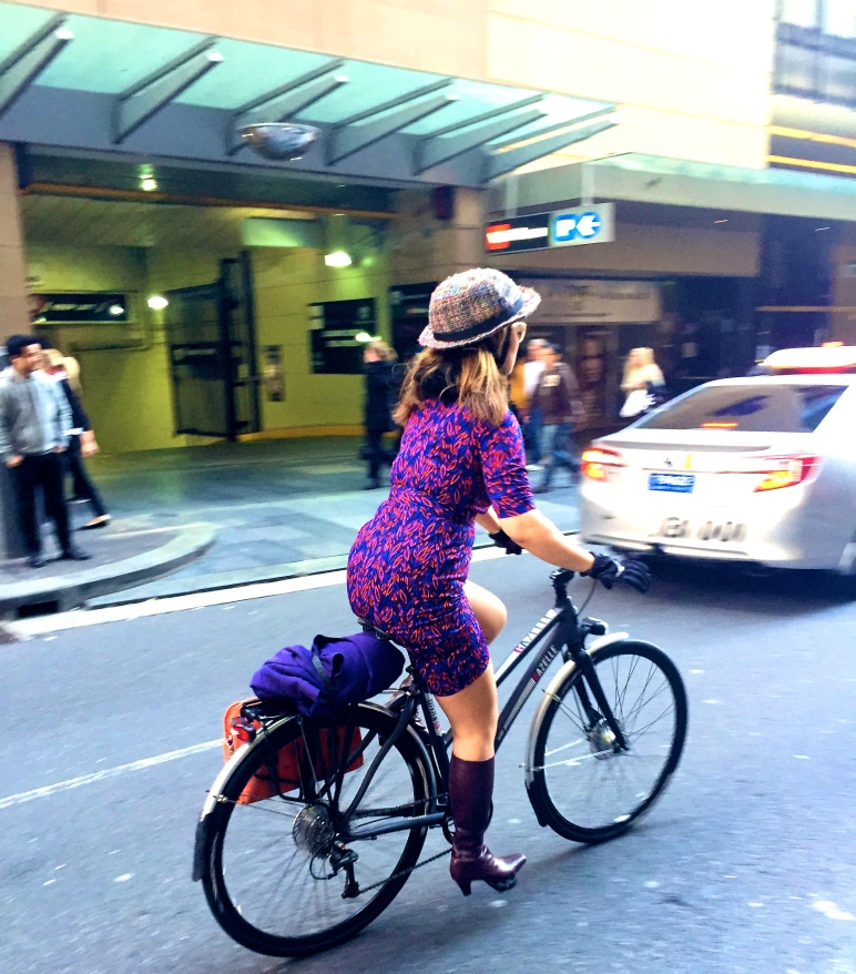 veloaporter bicycling in heels bicycling in a dress women on bicycles bicycling in the cold weather